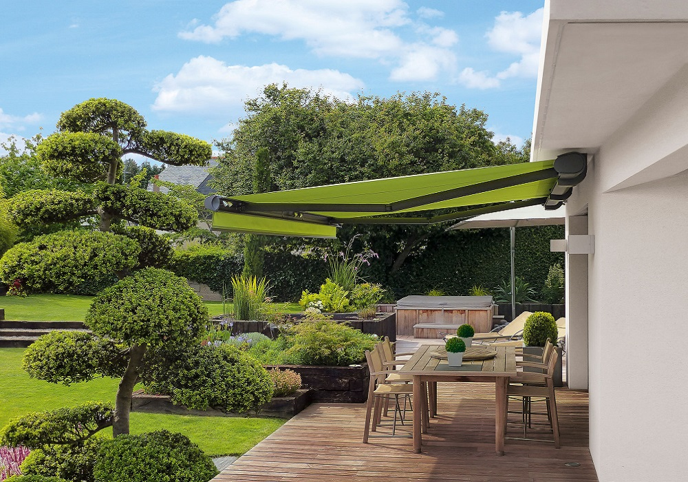 Beautiful garden with awning over decking area